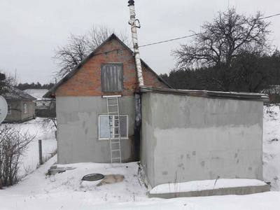 Тела четырех человек обнаружили под Харьковом (фото)