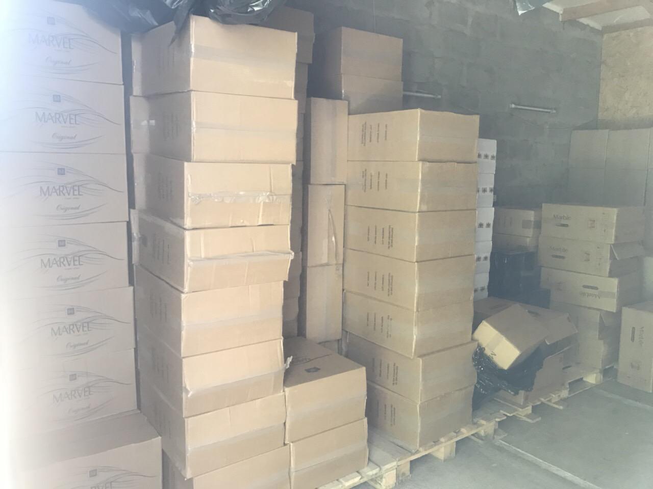 Миллионы нашли на складе в Харькове (фото)